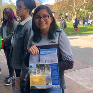 Student holding UC Santa Barbara brochure at UCSB